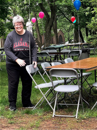 Sister Lynn Marie helps to set up for the picnic