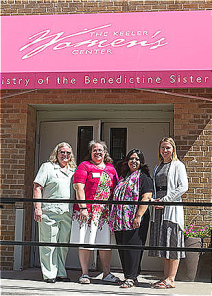 Sisters Bridget Dickason, drector, along with staff members Sister Suzanne Fitzmaurice, Brenda Mortel, and Rachel Willoughby welcome visitors to their new location
